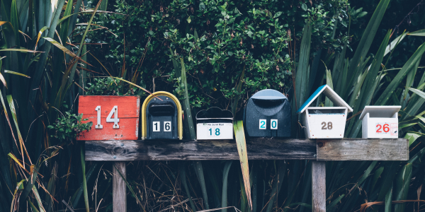 six multicolored mailboxes